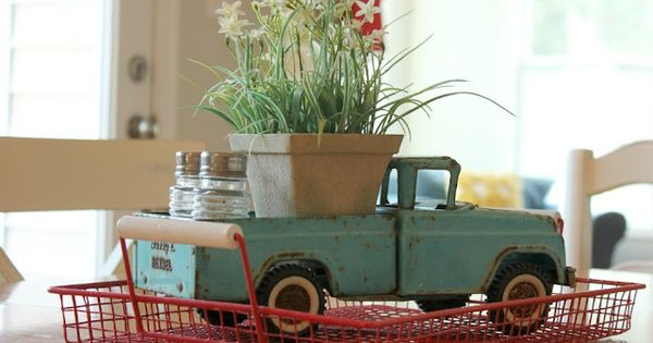 Vintage toy truck as a planter and salt pepper caddy. Cute for