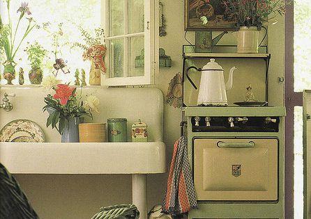 Cute cottage kitchen, interesting vintage stove.