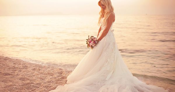 Bride photo on the beach at sunset.