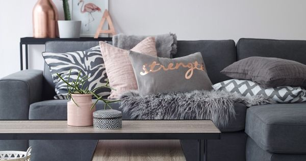 Modern living room in grey with copper and pink accents. Geometric diamond