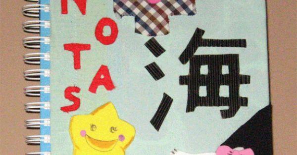 libreta estilo japones forrada con tela, las letras estan hechas con