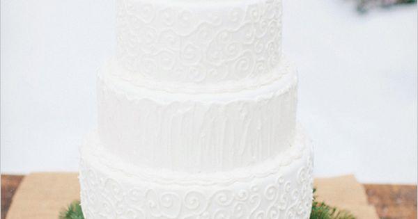 Rustic White Buttercream Wedding Cake with Winter Greenery & Pine Cones