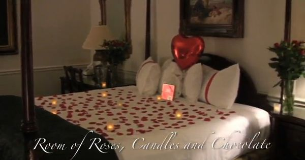 Room of roses candles and chocolate silk rose petals - Romantic decorations for hotel rooms ...