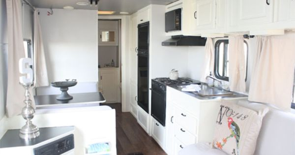 """RV camper trailer makeover: white cabinets, grey ceiling, """"wood"""" floor (probably Allure?),"""