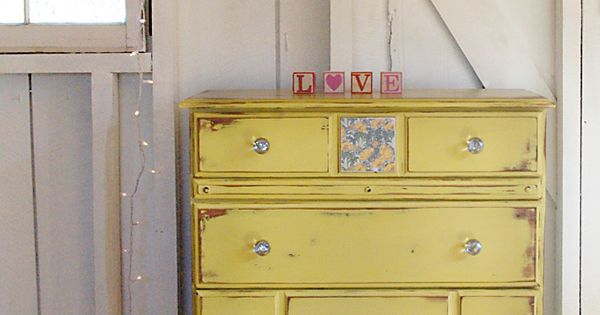 I love this! The colors are great! {Painted dresser, heart garland}