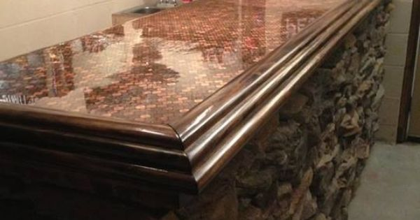 This is the bar we built for our mancave rock front for Copper penny bar top