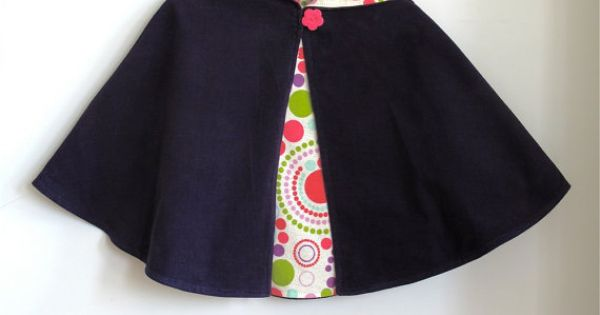 Purple corduroy infant or toddler hooded cape is lined with white flannel
