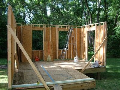 This l shaped storage shed was constructed using plans for L shaped shed designs