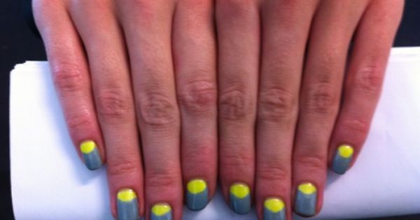 Beauty PR Rachael Jevons' slate grey and neon yellow nails, spotted backstage