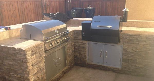 A Built In Traeger And Added Stainless Steel Accessories