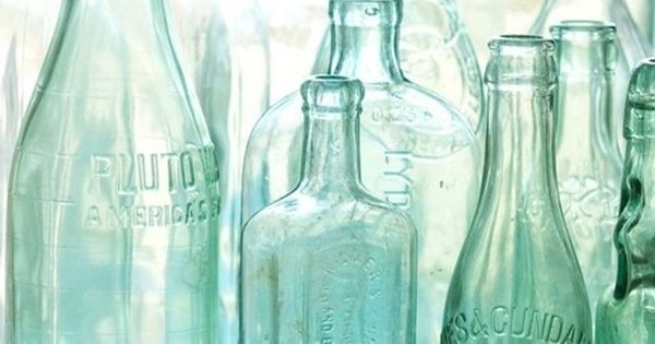 Antique bottles. No. 2, old blue green bottles in morning light with