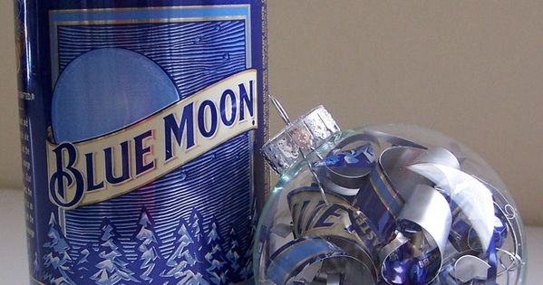 a clear glass ornament was filled with spirals hand cut from blue moon belgian white beer cans