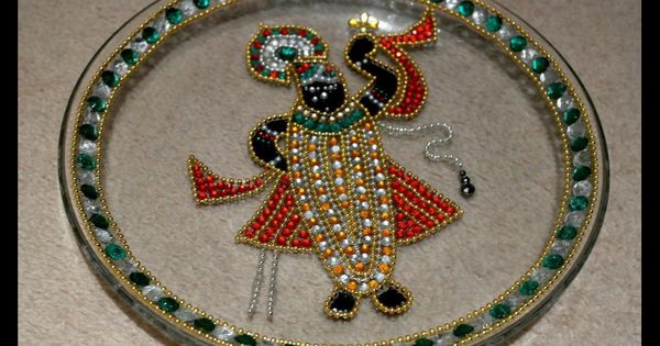 Shrinathji rangoli aarti a hindu god crystallized on a for Aarti thali decoration with grains