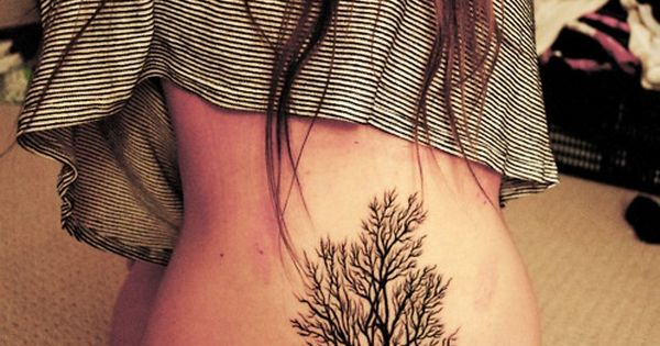 The beauty of this tree tattoo lies in it's simplicity. InkedMagazine black