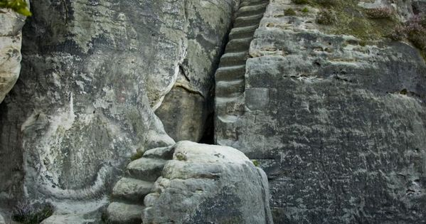 Precarious mountain stairs carved into the bedrock