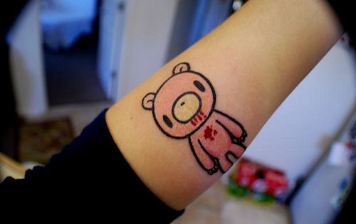 A kawaii tattoo with the pink bear Gloomy Bear