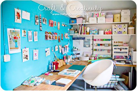 Craft studio in basement. I love the bright wall and hanging