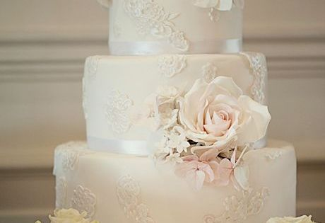Ivory Wedding Cake with Lace Appliques.
