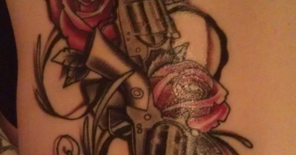 Guns and roses on back done at a brand new tattoo in eau for Eau claire tattoo