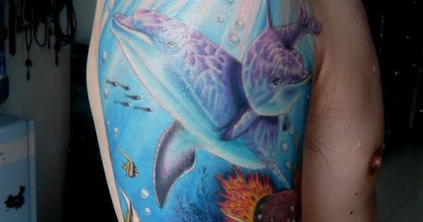 Dolphin the meaning of tattoo full arm saratattooimages for What does a dolphin tattoo symbolize