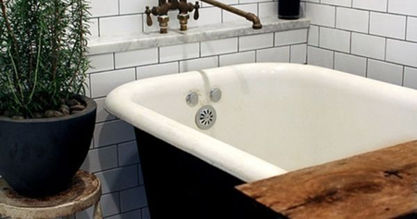 a lot of genius here. clawfoot tub + wood plank. a giant