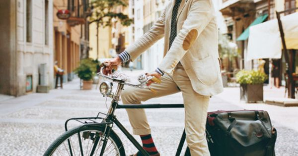 A white beard, striped socks, elbow patches and shades. On a bicycle.