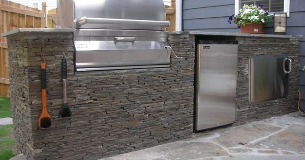 Outdoor Kitchen With Sacked Stone Drop In Grill