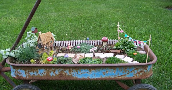 Fairy Garden in an old rusty wagon! They'd wreck this right away