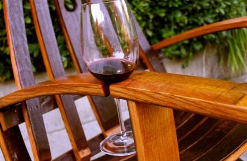 Yes! Adirondack Chair w/ wine glass holder on arm made from a