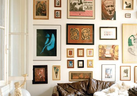 living room gallery wall with large and small frames