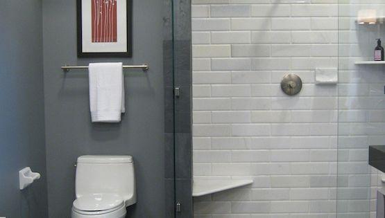 Slate floors and white subway tile shower.