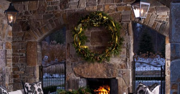 An oversized wreath complements the large scale of this OUTDOOR living room