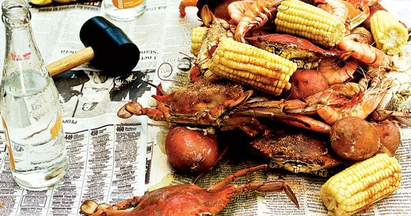 a Southern feast of crab boil served on newsprint crabboil