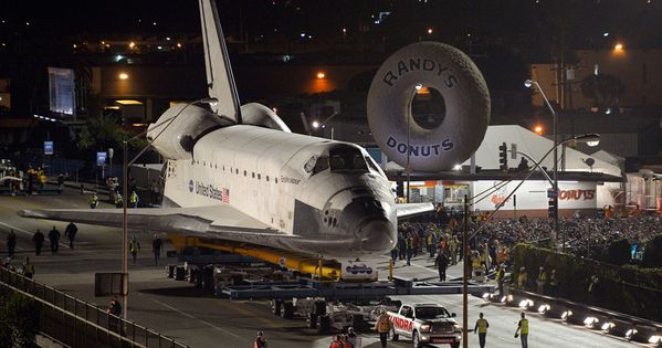 The Endeavor passes Randy's Donuts en route to the California Science Center