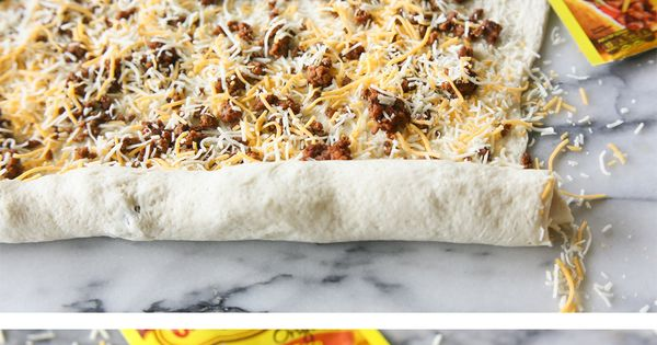 Looking for a new twist on taco night - or a delicious appetizer to share? Try these Taco Pizza Rolls from @GirlWhoAte! Roll up taco meat and cheese, and bake!