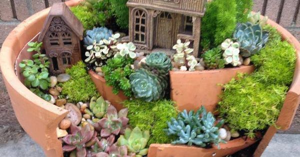 Miniature fairy garden in a pot from a broken terra cotta flower