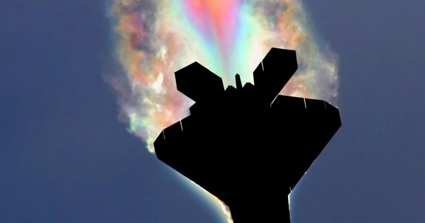 An F-22 Raptor's condensation rainbow.