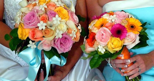 Wedding Flowers Warren Mi : Bridal bouquet of pink peach yellow and ivory roses