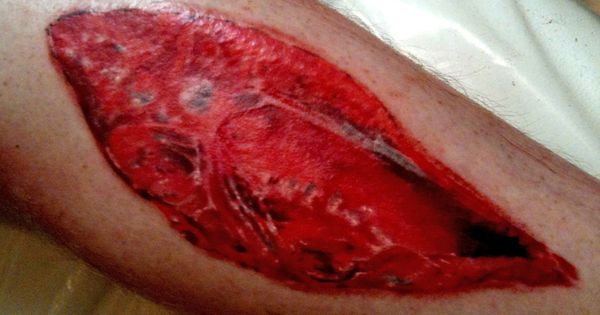 Flesh tattoos ripped skin open wound leg tattoo by for Flesh wound tattoo