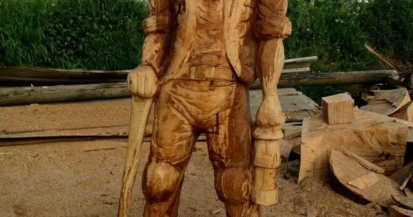 Coal miner carved from beech with a chainsaw carvings