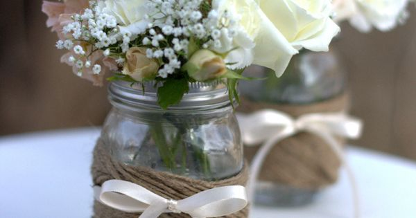 Mason jar centerpiece with roses and babybreath.