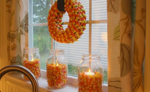 Fill Mason jars with Candy Corn & stick a tea light or