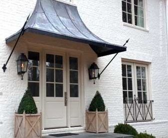 Historic Curb Apeal Taking Care Of Your Tudor Metal Door Awning Door Awnings Door Overhang