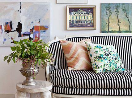 Art wall | gallery wall frames stripes sofa settee living room striped