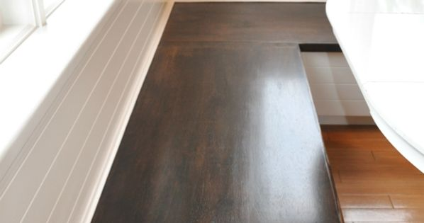 Kitchen banquette -- stained seat (easy to slide in, easy to clean),