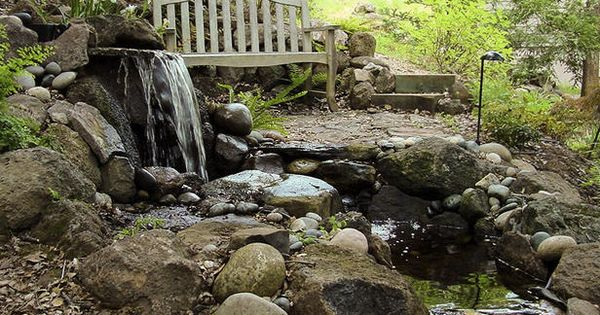 Rustic waterfall and pond 520x390 The Perfect Outdoor Space for Pond