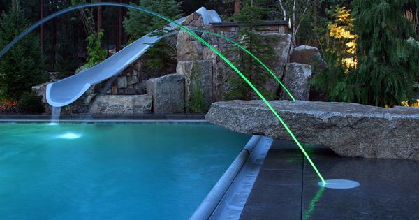 Led Lit Laminar Jets Adorn This Pool Surrounded By