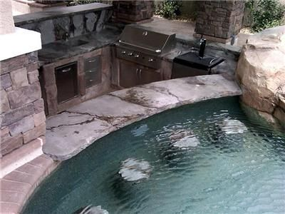 Outdoor Kitchen Design Offers Unique Dining Experience For Swimmers Arizona Falls Las Vegas Outdoor Kitchen Design Outdoor Kitchen Bars Backyard Pool Designs