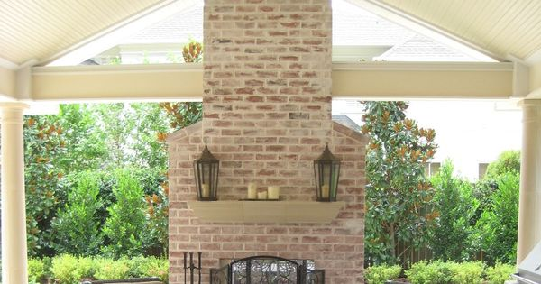 See Through Brick Fireplace With Custom Gable Porch