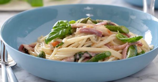 Cooking Channel serves up this Spaghetti with Asparagus, Smoked Mozzarella and Prosciutto